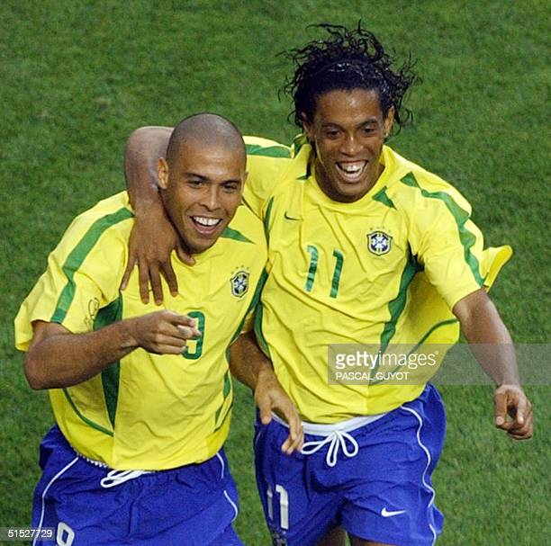 Brazil's Ronaldo is congratulated by teammate Ronaldinho after scoring a 50th minute equalizer against Turkey 03 June 2002 in Ulsan's Munsu Football...