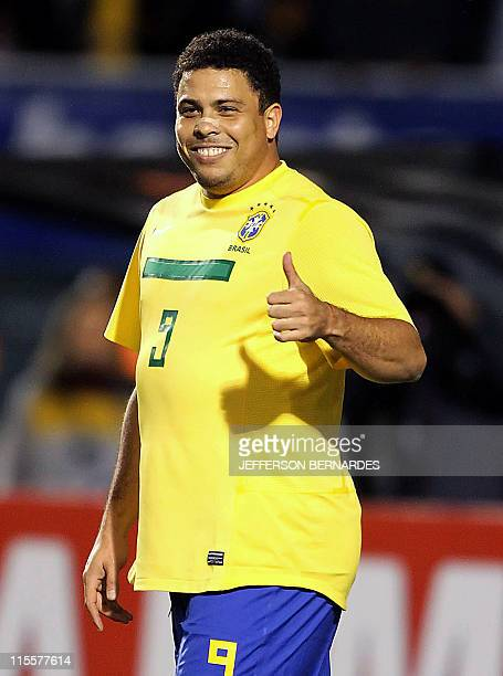 Brazil's Ronaldo Nazario gives his thumb up during the friendly football match against Romania at the Pacaembu stadium in Sao Paulo on June 7 Brazil...