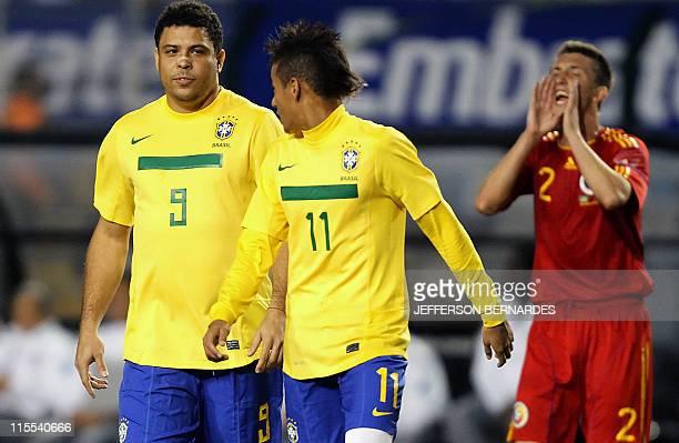 Brazil's Ronaldo Nazario walks next to teammate Neymar during their friendly football match against Romania at the Pacaembu stadium in Sao Paulo on...