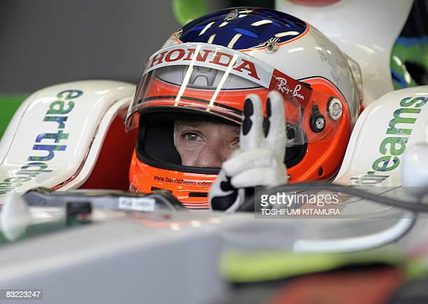 Brazil's Rubens Barrichello prepares for the free practice session of the Formula One Japanese Grand Prix at the Fuji Speedway, on October 11, 2008....