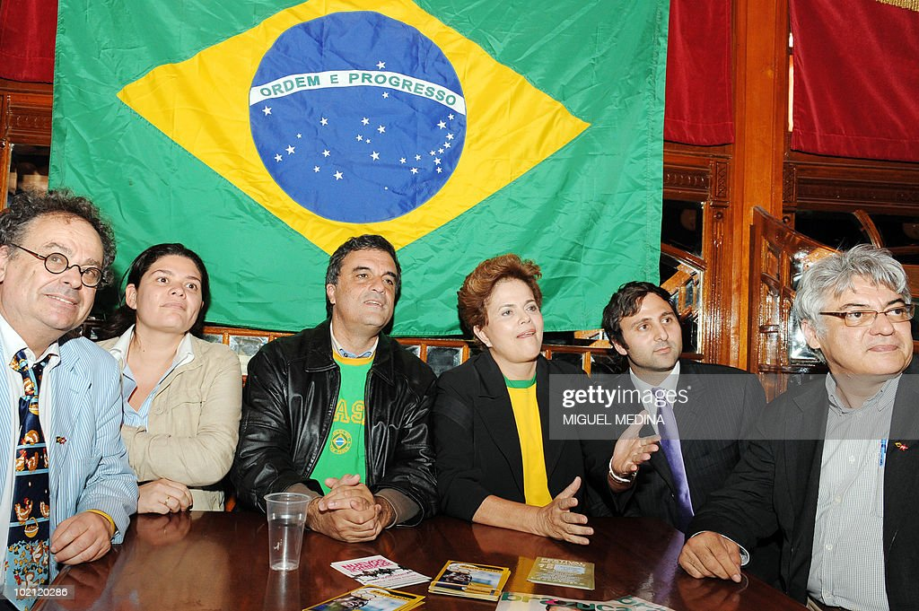 Brazil's ruling left-wing Workers Party candidate for the next October presidential elections Dilma Rousseff (3rdR) and Workers Party deputy Jose Eduardo Cardozo (3rdL) watch the screening of the 2010 Fifa World Cup football match Brazil vs North Korea on June 15, 2010 in Paris. Rousseff, a 62-year-old economist who served as energy minister before she became Lula's chief of staff, started today a visit in Europe to meet with European leaders. (From L to R) French researcher Jean-Jacques Kourliandsky, Member of the French 'Parti de Gauche' (Left Party) Raquel Garrido, Jose Eduardo Cardozo, Dilma Rousseff, French Socialist Party regional councillor Eduardo Cypel and an unidentified man.