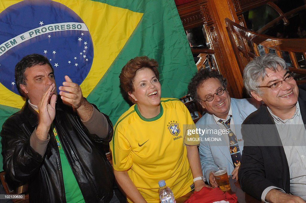 Brazil's ruling left-wing Workers Party candidate for the next October presidential elections Dilma Rousseff (C), Workers Party deputy Jose Eduardo Cardozo (L), French researcher Jean-Jacques Kourliandsky (2ndR) and an unidentified man watch the screening of the 2010 Fifa World Cup football match Brazil vs North Korea on June 15, 2010 in Paris. Rousseff, a 62-year-old economist who served as energy minister before she became Lula's chief of staff, started today a visit in Europe to meet with European leaders.