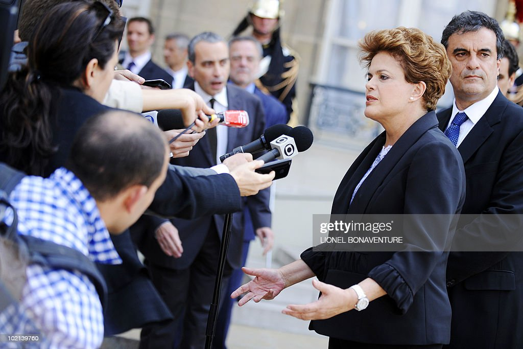Brazil's ruling left-wing Workers Party candidate for the next October presidential elections Dilma Rousseff (C) answers to journalists questions after a meeting with French president Nicolas Sarkozy, on June 16, 2010 at the Elysee palace in Paris.