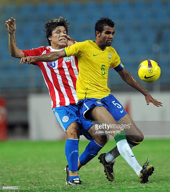 "Brazil's Sandro vies for the ball with Paraguay's Sederico Santander during their U-20 South American Championship football match at the ""Jose..."