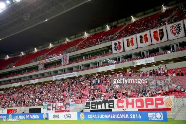 Brazil's Santa Cruz fans cheers for their team durinf the Copa Sudamericana football match against Brazil's Sport Recife at Arena Pernambuco stadium...