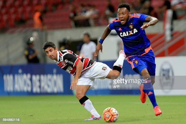Brazil's Santa Cruz player Pisano vies for the ball with Brazil's Sport Recife player Rodney during their Copa Sudamericana match at Arena Pernambuco...