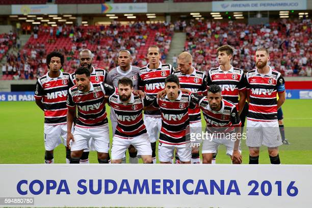 Brazil's Santa Cruz team pose before the Copa Sudamericana match against Brazil's Sport Recife at Arena Pernambuco stadium in Recife on August 24...