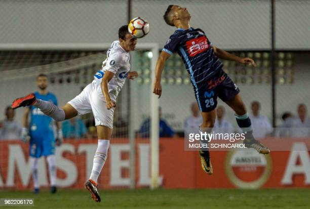 Brazil's Santos Diego Pituca vies for the ball with Jean Archimbaud of Peru's Real Garcilaso during their 2018 Copa Libertadores football match held...