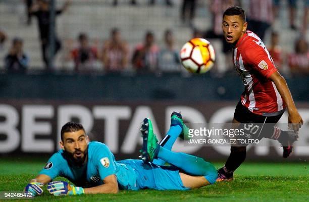 Brazil's Santos goalkeeper Vanderlei dives for the ball kicked by Argentina's Estudiantes de La Plata forward Carlos Lattanzio during their Copa...