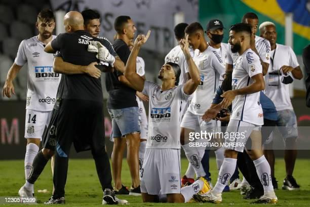 Brazil's Santos Lucas Verissimo and teammates celebrate after defeating Argentina's Boca Juniors 3-0 in their Copa Libertadores semifinal football...