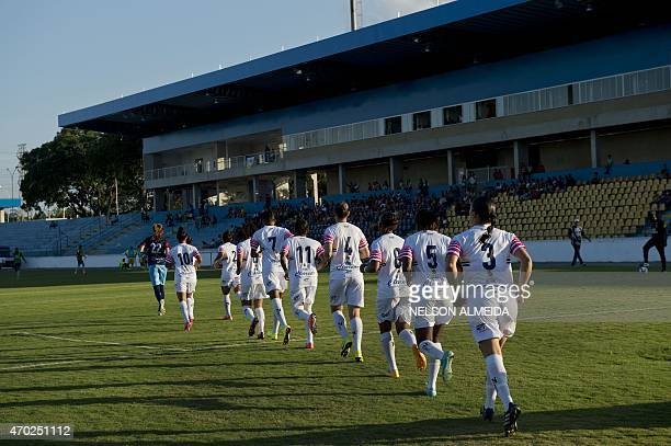 Brazil's Sao Jose footballers enter the field for a friendly match against Brazil national team at Martins Pereira stadium on April 4 in Sao Jose dos...