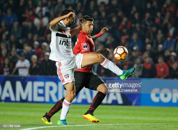Brazil's Sao Paulo midfielder Nene vies for the ball with Argentina's Colon forward Alan Ruiz during their Copa Sudamericana football match at the...