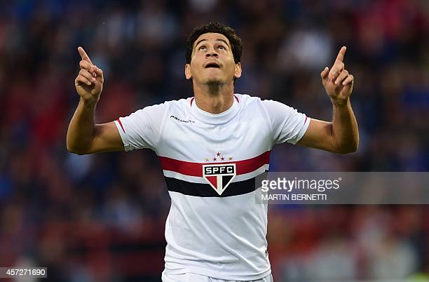 Brazil's Sao Paulo's player Ganso celebrates after scoring against Huachipato during their Copa Sudamericana football match at the Cap Stadium in...