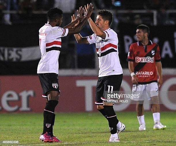 Brazil's Sao Paulo's players Alexander Pato and Michel Bastos celebrate the goal against Uruguay's Danubio during their Libertadores Cup football...