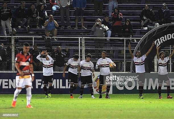 Brazil's Sao Paulo's players celebrates the second goal against Uruguay's Danubio during their Libertadores Cup football match at the Franzini...