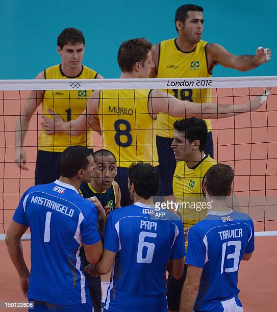 Brazil's Sergio Santos talks with Italy's players during their men's volleyball semifinal match of the London 2012 Olympics Games in London on August...