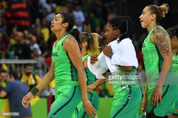 Brazil's shooting guard Iziane Castro Brazil's point guard Joice Rodrigues and Brazil's centre Erika Souza recat after a Women's round Group A...