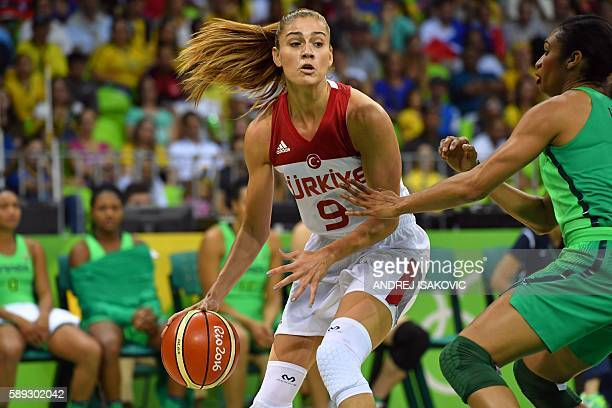 Brazil's shooting guard Iziane Castro holds off Turkey's power forward Bahar Caglar during a Women's round Group A basketball match between Turkey...