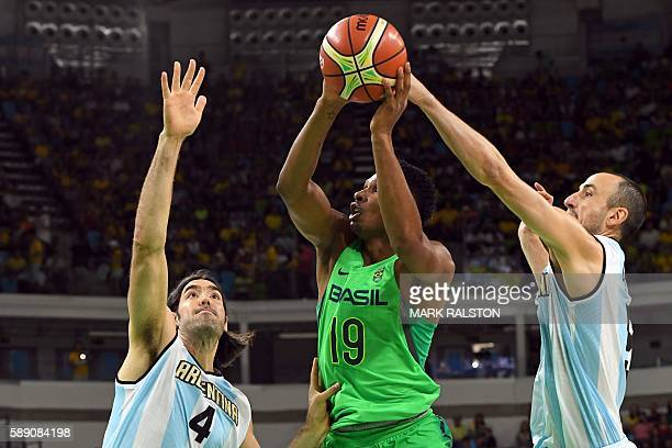 Brazil's shooting guard Leandro Barbosa 9C goes to the basket between Argentina's power forward Luis Scola 9L and Argentina's shooting guard Manu...