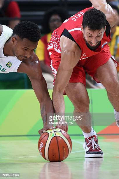 Brazil's shooting guard Leandro Barbosa 9L and Croatia's point guard Roko Ukic go for the ball during a Men's round Group B basketball match between...