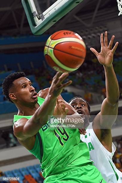 Brazil's shooting guard Leandro Barbosa passes the ball under pressure from Nigeria's power forward Ike Diogu during a Men's round Group B basketball...