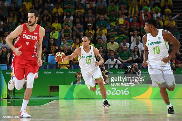 Brazil's small forward Alex Garcia dribbles next to Croatia's small forward Luka Babic and Brazil's shooting guard Leandro Barbosa during a Men's...