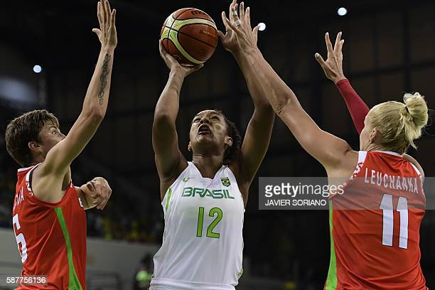 TOPSHOT Brazil's small forward Damiris Dantas shoots past Belarus' small forward Katsiaryna Snytsina and Belarus' centre Yelena Leuchanka during a...
