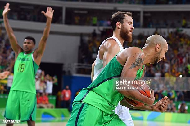 Brazil's small forward Marcus Vinicius Marquinhos and Brazil's shooting guard Leandro Barbosa react next to Spain's point guard Sergio Rodriguez...