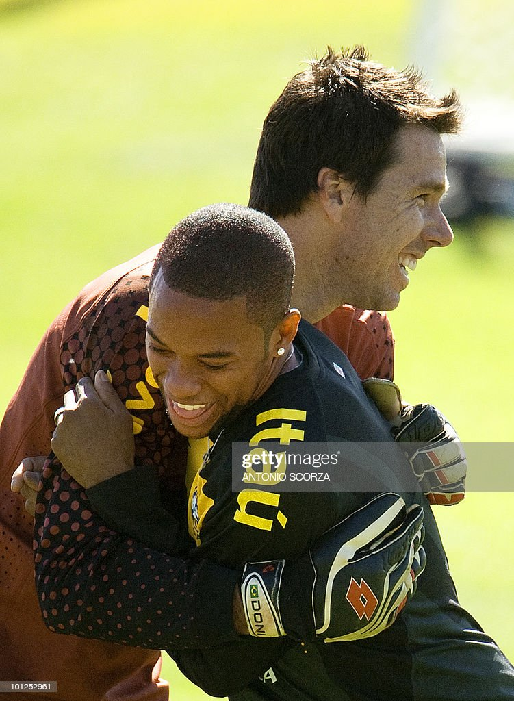 Brazil's soccer striker Robinho (L) hugs second goalkeeper Doni after a practice session at Randburg High School in Johannesburg, on May 29, 2010 preparing to dispute the 2010 FIFA World Cup, in South Africa. AFP PHOTO / ANTONIO
