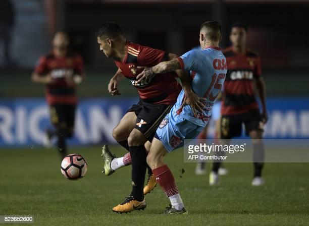 Brazil's Sport Recife midfielder Diego Souza vies for the ball with Argentina's Arsenal midfielder German Ferreyra during their Copa Sudamericana...