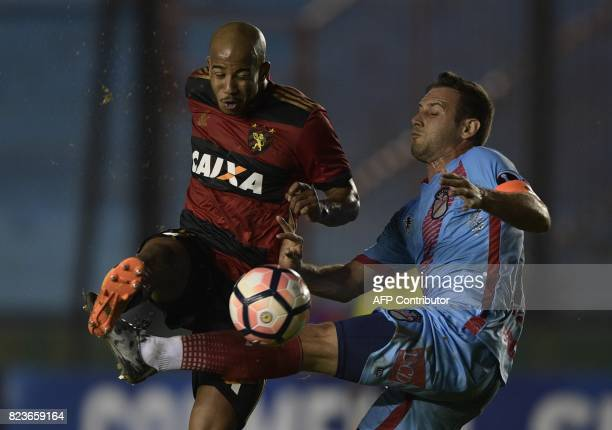 Brazil's Sport Recife midfielder Patrick vies for the ball with Argentina's Arsenal defender Claudio Corvalan during their Copa Sudamericana second...