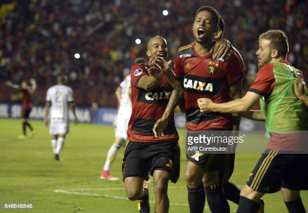 Brazil's Sport Recife player Andre Felipe celebrates with teammates after scoring against Brazil's Ponte Preta during the Copa Sudamericana football...