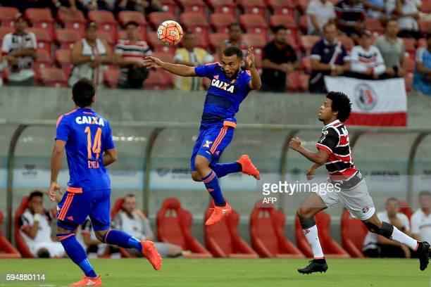 Brazil's Sport Recife player Xavier heads the ball during the Copa Sudamericana match against Brazil's Santa Cruz at Arena Pernambuco stadium in...