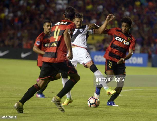 Brazil's Sport Recife players Durval and Rithely vie for the ball with Uruguay's Danubio player Joaquin Ardaiz during their Copa Sudamericana 2017...
