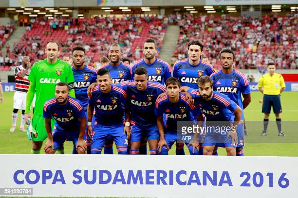 Brazil's Sport Recife team pose before the Copa Sudamericana match against Brazil's Santa Cruz at Arena Pernambuco stadium in Recife on August 24...