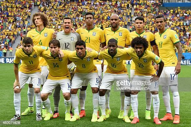 Brazil's squad defender David Luiz goalkeeper Julio Cesar forward Jo defender Maicon defender and captain Thiago Silva midfielder Luiz Gustavo...