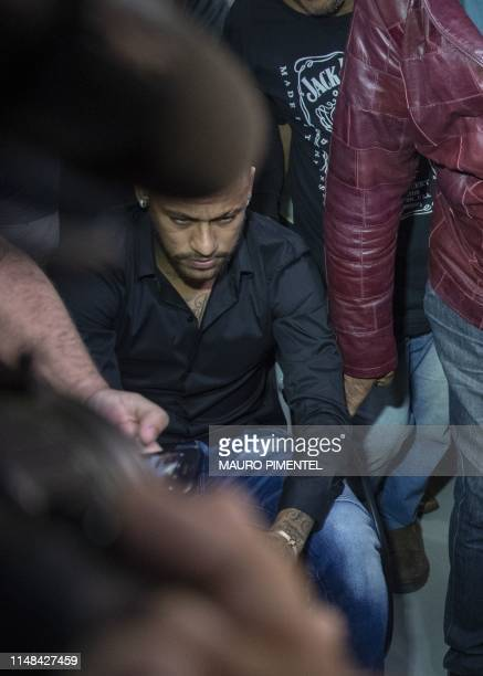 Brazil's star striker Neymar arrives using a wheelchair to the Police Station to give a statement for posting intimate WhatsApp messages with Najila...
