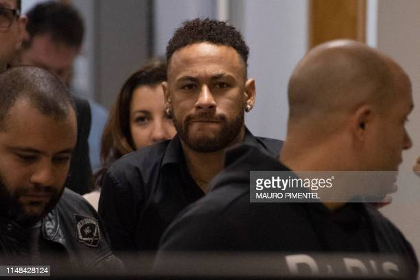 TOPSHOT Brazil's star striker Neymar leaves a Police Station after giving a statement to police for posting intimate WhatsApp messages with Najila...