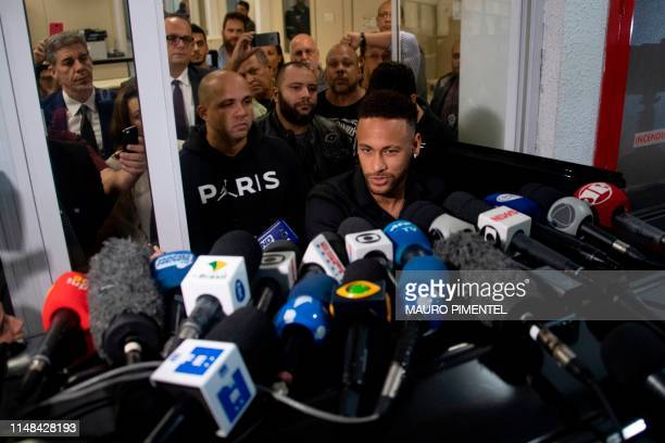Brazil's star striker Neymar leaves a Police Station after giving a statement to police for posting intimate WhatsApp messages with Najila Trindade...