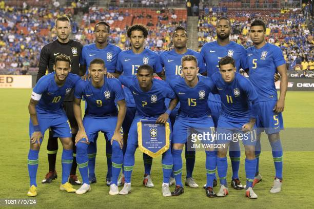 Brazil's starting line up pose for pictures during the international friendly match between El Salvador and Brazil at FedEx Field in Landover...