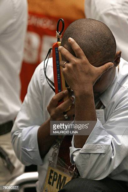 A Brazil's stock trader negotiates during the morning session at the Mercantile Futures Exchange in Sao Paulo Brazil 14 August 2007 World stock...