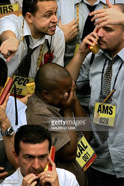 Brazil's stock traders negotiate at iBovespa index pit prior to the morning closing time at the Mercantile Futures Exchange in Sao Paulo Brazil 10...