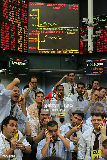 Brazil's stock traders negotiate at the future dollar pit prior to the morning closing time at the Mercantile Futures Exchange in Sao Paulo Brazil 10...