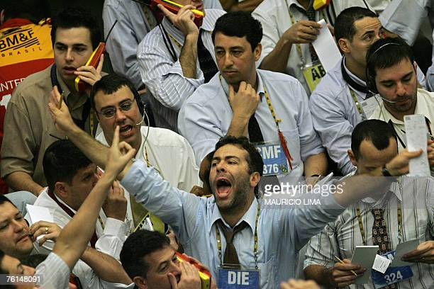 Brazil's stock traders negotiate at the iBovespa future index pit during the morning session at the Mercantile Futures Exchange in Sao Paulo Brazil...