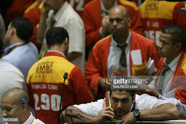 Brazil's stock traders negotiate during the morning session at the Mercantile Futures Exchange in Sao Paulo Brazil 31 January 2008 European shares...
