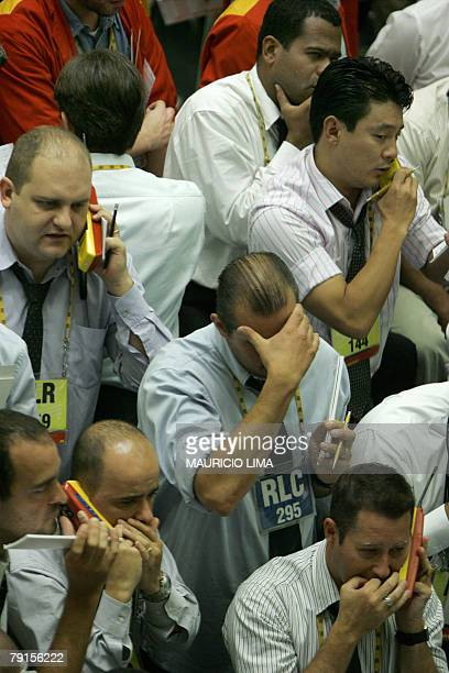Brazil's stock traders negotiate in the future dollar pit during the morning session at the Mercantile Futures Exchange in Sao Paulo Brazil 22...