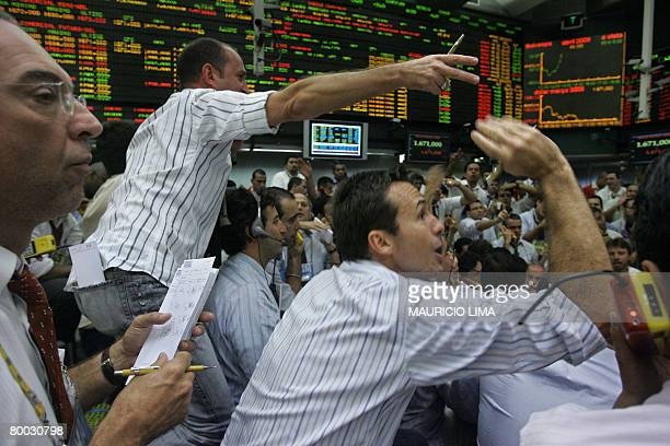 Brazil's stock traders negotiate in the future dollar pit during the morning session at the Mercantile Futures Exchange in Sao Paulo Brazil on...