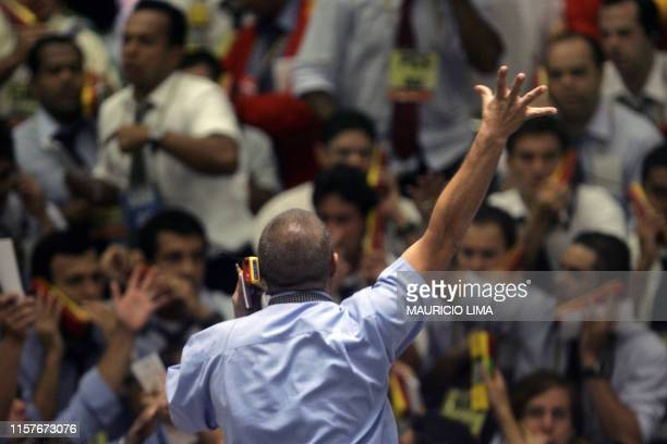 Brazil's stock traders negotiate in the future dollar pit prior to the closing time at the Mercantile Futures Exchange in Sao Paulo Brazil on March...
