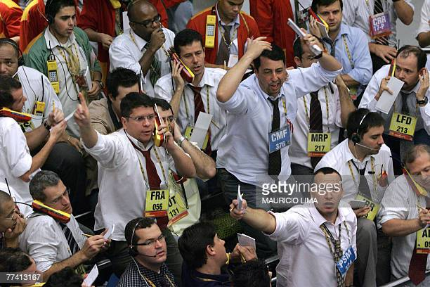 Brazil's stock traders negotiate in the iBovespa index pit prior to the morning closing time at the Mercantile Futures Exchange in Sao Paulo Brazil...