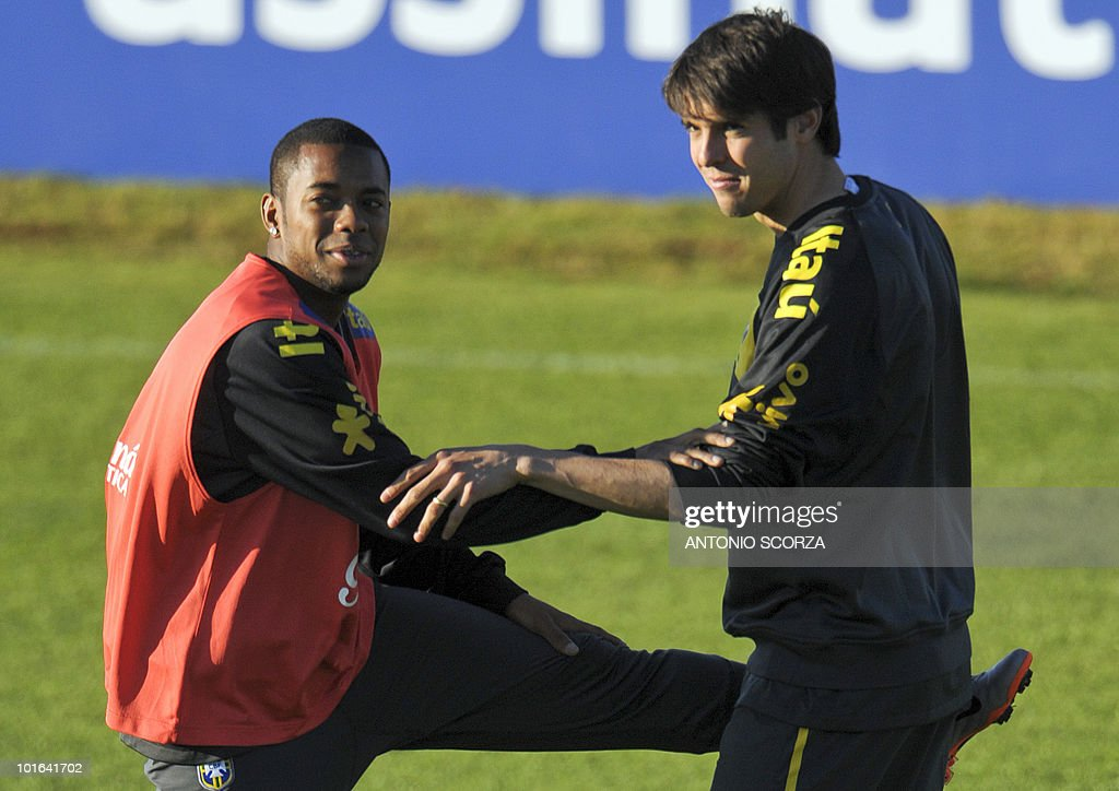 Brazil's striker Kaka (R) stretches with teammate Robinho during a training session at the Randburg High School on June 5, 2010 in Johannesburg. The team is preparing to compete in the 2010 World Cup in South Africa.